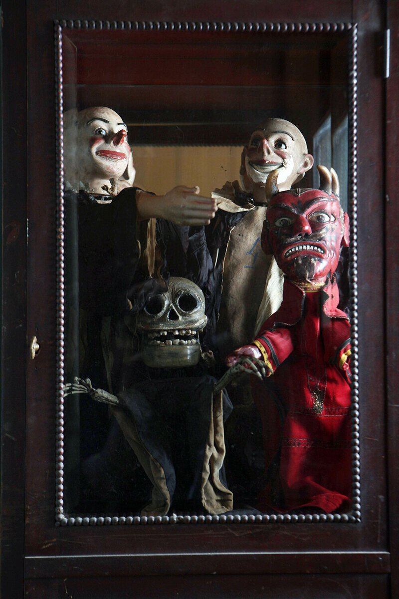 Antique puppets and automatons. The skeleton has real human teeth and the devil sports real animal horns.