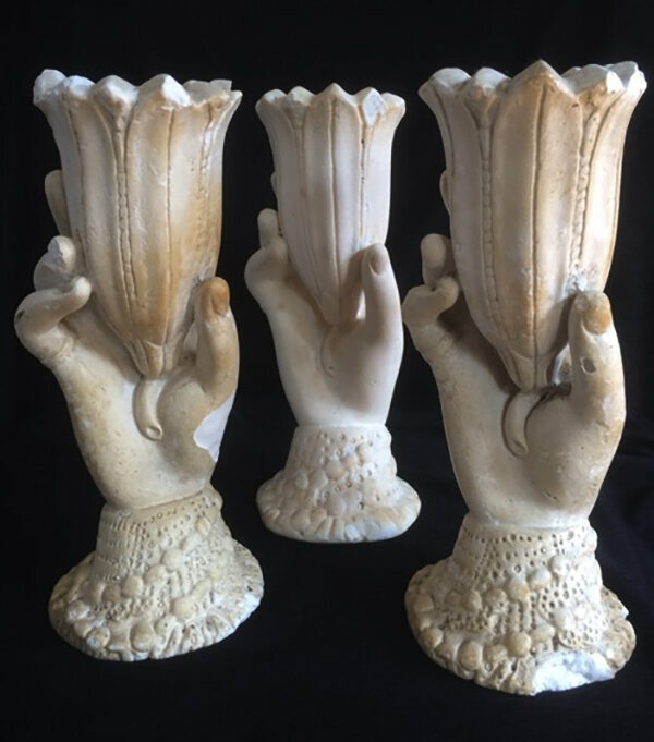 A trio of chalkware hands, maker and date unknown. Though the cheapest version in their day, chalkware hands are the rarest and most valuable today due to their extreme fragility.