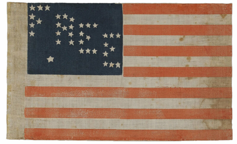 "A 35-Star ""free"" Abraham Lincoln campaign flag, 1864. ""Thirty-five stars arranged to spell ""FREE"" proclaim the Republican Party's opposition to slavery during the Civil War and, with the extra star, anticipates the addition of Nevada as a new state."""