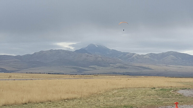 Paramotor pilot taking off from an airfield in Downey, Idaho.