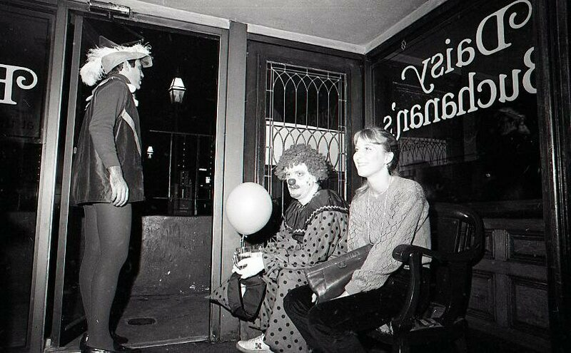 Three revelers take a break during Mayor White's 1980 Halloween party.