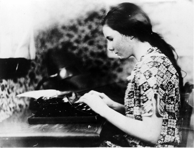 Follett at her typewriter in 1928.