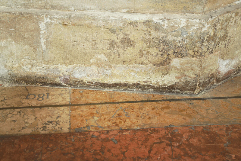 The meridian line cuts diagonally through the church interior, narrowly missing  this support column. Although cathedral interiors were nearly ideal spaces for the  installation of meridian lines, they also posed many unique challenges.