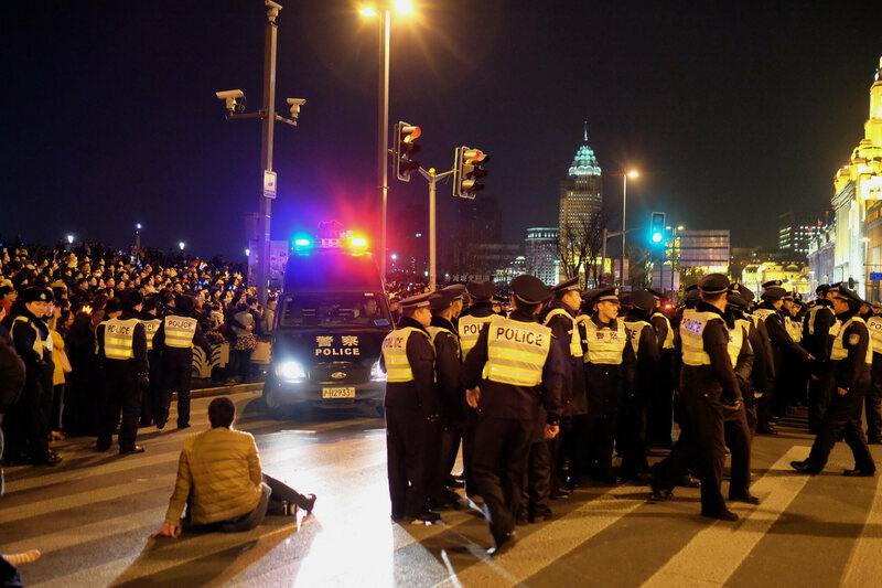 Law enforcement assessing the crowds after the tragedy on the Bund in Shanghai.