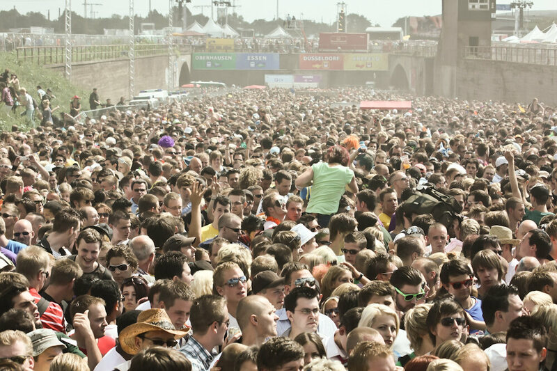 People innocently packed into the Love Parade 2010 venue just moments before a chaotic outbreak.
