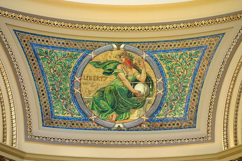 Mosaic of liberty holding a glass ballot box in the Michigan State Capitol.