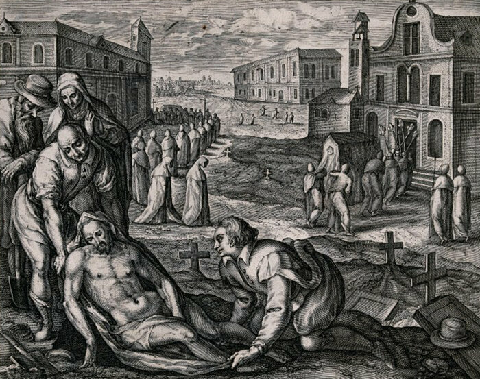A male corpse is wrapped in linen as a funeral processes into a church in the background, early 1600s.