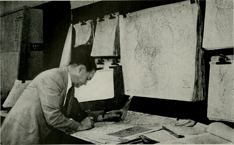 Working on data for a weather chart, c. 1922.