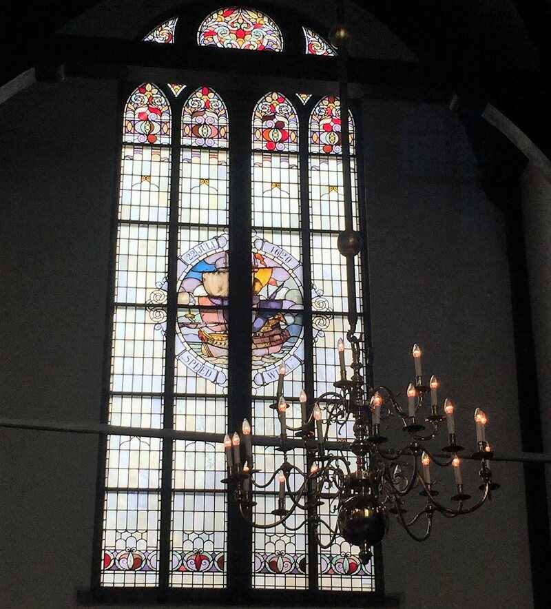 The stained glass window honoring the <em>Speedwell</em>.