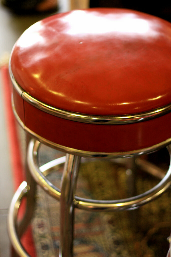 A pleather counter stool.