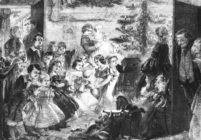 A Victorian family gathered around the Christmas Tree.
