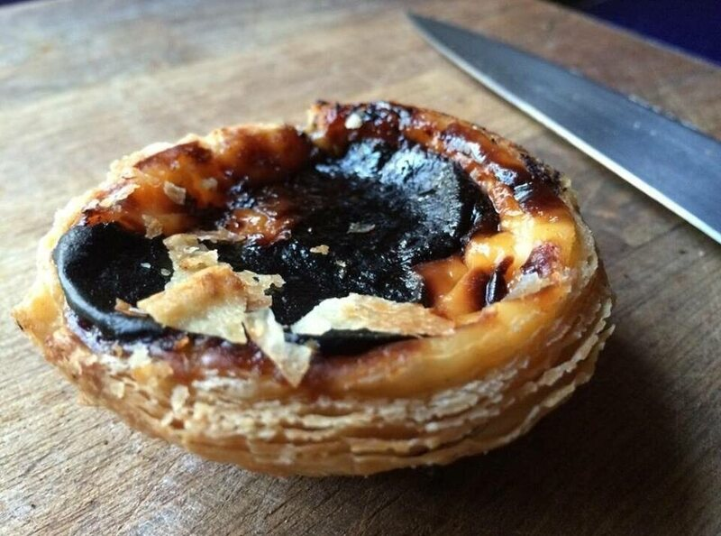 Pastel de nata—the slightly burnt pieces are the best part.