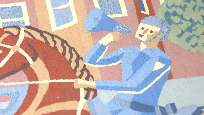 A detail of one of the tapestry's policemen, wielding a hunting-horn megaphone.