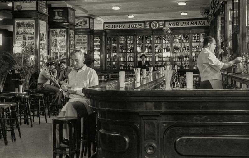 "Alec Guinness at Sloppy Joe's bar while filming ""Our Man in Havana."""