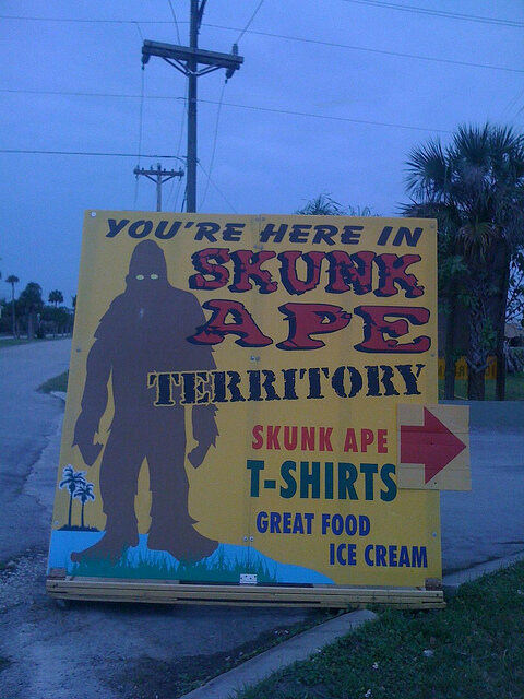 "A sign directs visitors to ""SKUNK APE TERRITORY."""