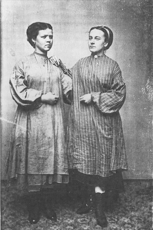 "A 19th century tintype of two ""Lowell Mill Girls."""