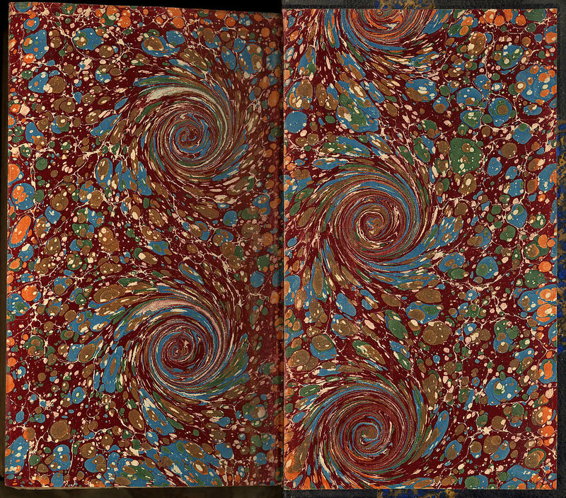 Handcrafted marbled endpapers of a book manually bound in France around 1880.