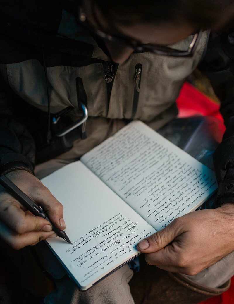 José Padial records the day's observations in his field notebook.