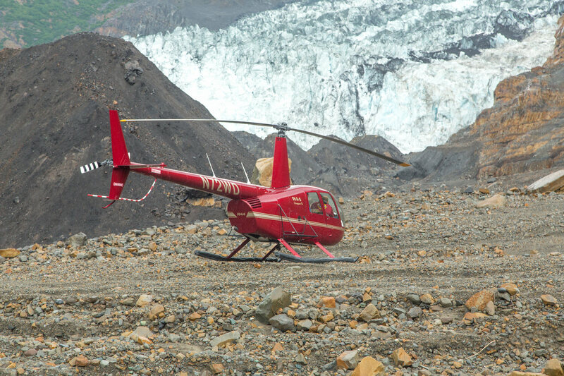 A Robinson 44 helicopter pauses on landslide debris, used to help scientists get an aerial perspective and extend their research reach.