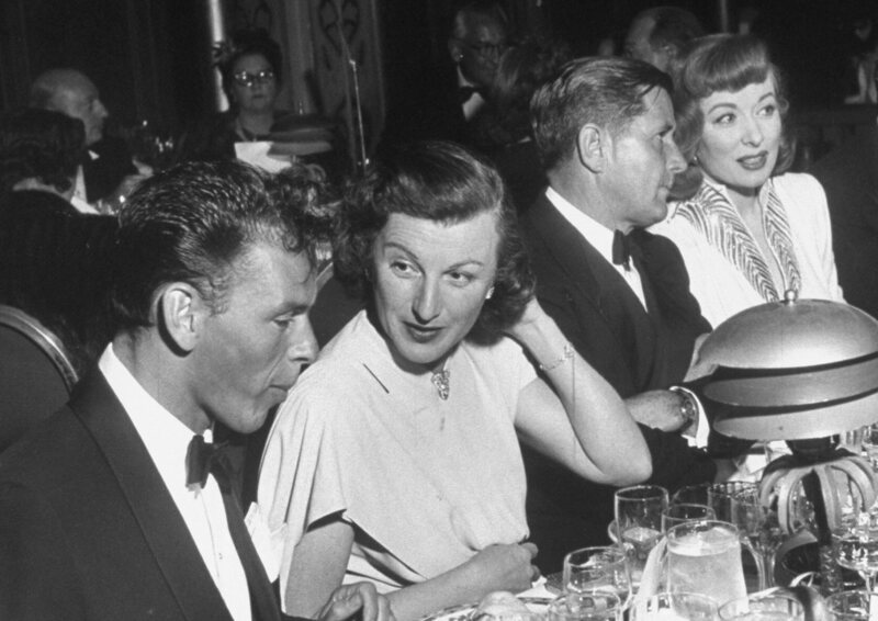 Howard Strickland, head of MGM Publicity (second from right) with Greer Garson. Frank Sinatra and Louella Parsons have other scandals to talk about.