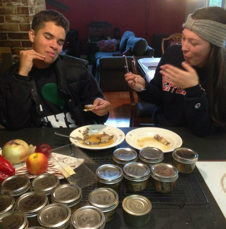 Teenagers eating canned shad.