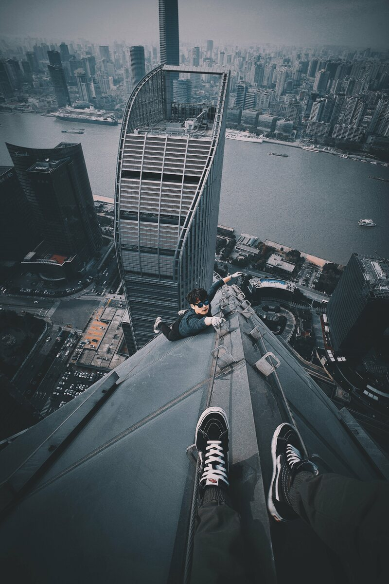 One of cocoanext's many vertigo-inducing photos taken atop the high-rises of Shanghai.