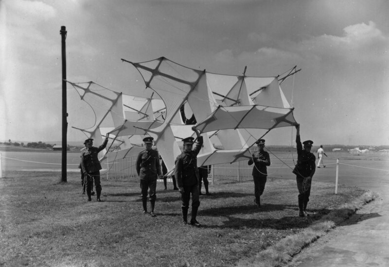 "The 4th Training Regiment of Royal Engineers displaying ""Cody Kites"" at the 50th anniversary of the Royal Aircraft Establishment (1955)."