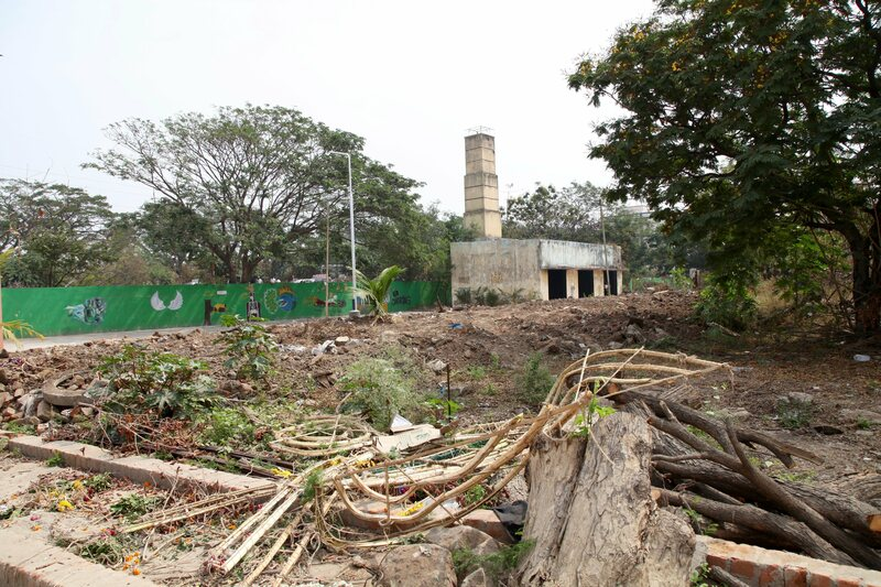 A disused burial ground is being leveled and turned into a park. In the background is the old cremation chamber where bodies were burnt on wooden pyres.