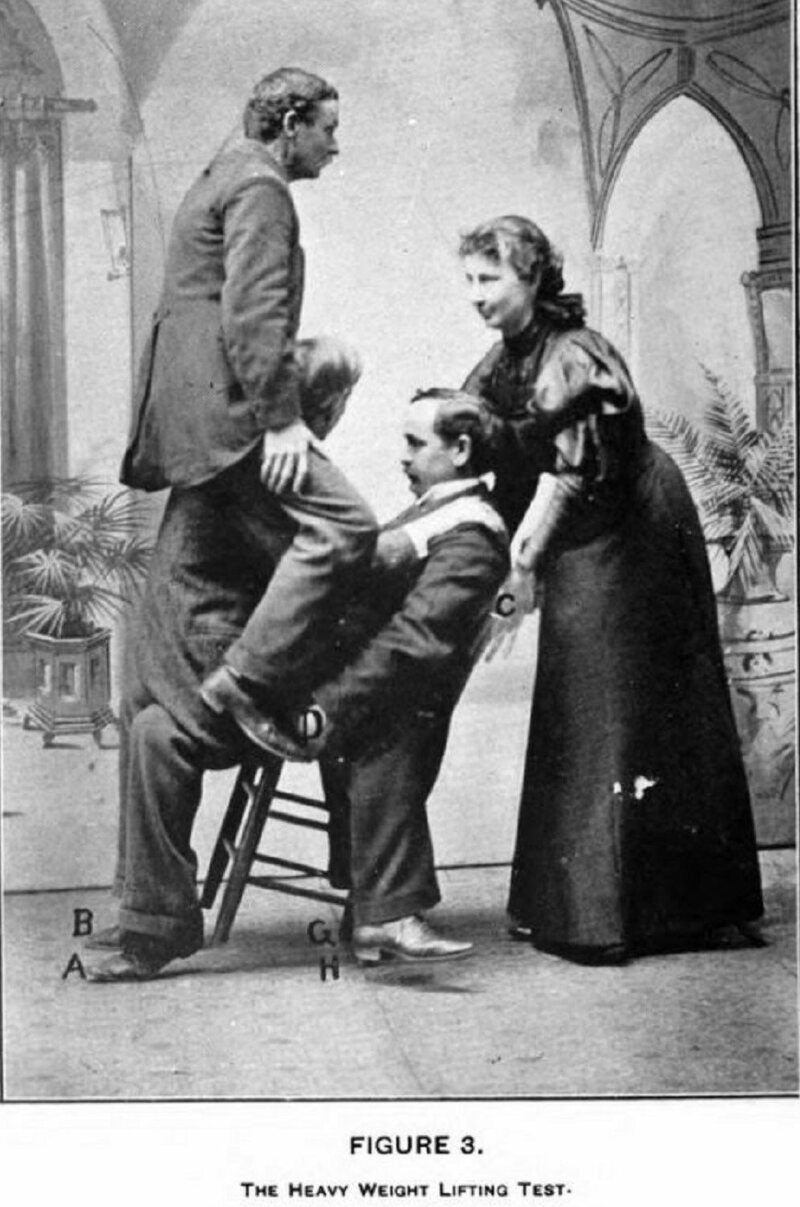 Lulu Hurst demonstrating her technique of overpowering three men on a chair.