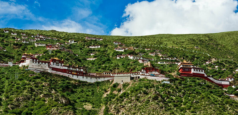 The monastery complex includes prayer halls, temples, and residences.