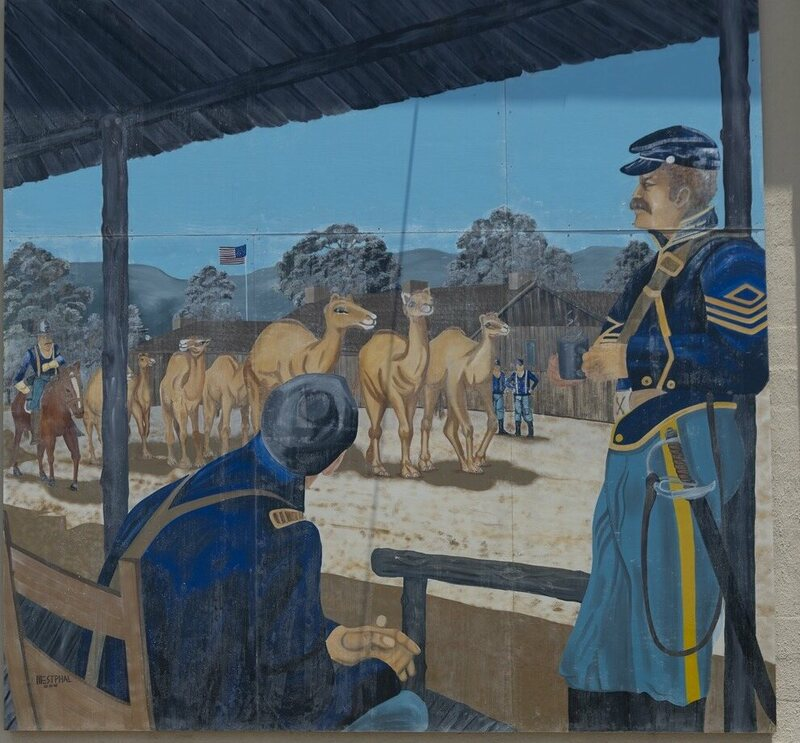 This mural, by Patrick Westphal, depicts the arrival of the Camel Corps in Cape Verde, Texas.
