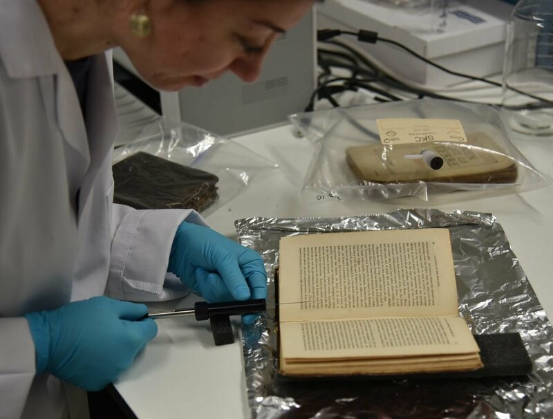 Cecilia sampling the volatile organic compounds (VOCs) of a historic book using solid phase microextraction (SPME) at the Heritage Science Lab in UCL.