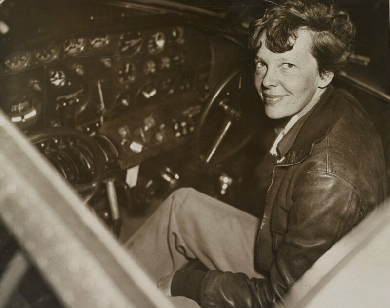 Amelia Earhart, sitting in the cockpit of an Electra airplane, was on the guest list in 1932 for the Society of Women Geographers first dinner.