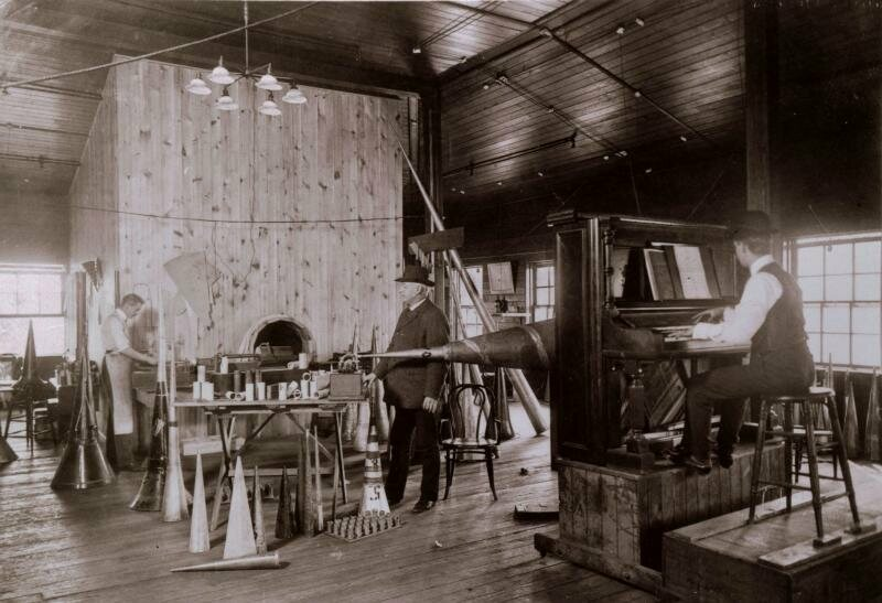What recording a song looked like in 1905. Here, a piano player records directly into a phonograph horn, which carves the music directly onto a 78 record.