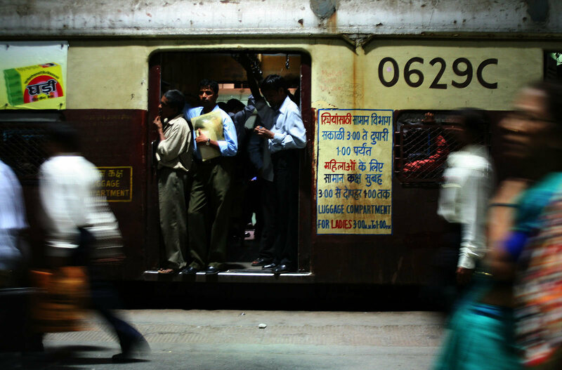 "A typical weekday train in Mumbai. The sign on the right side indicates that this becomes a ""Ladies Compartment"" at certain times."