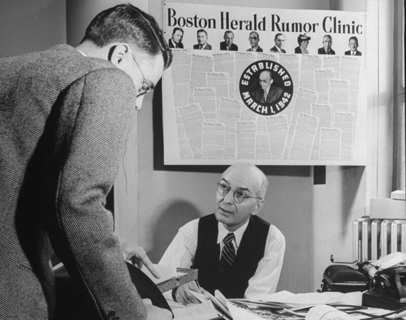 "Boston Herald assistant publisher W.G. Gavin at the ""Rumor Clinic,"" 1942."