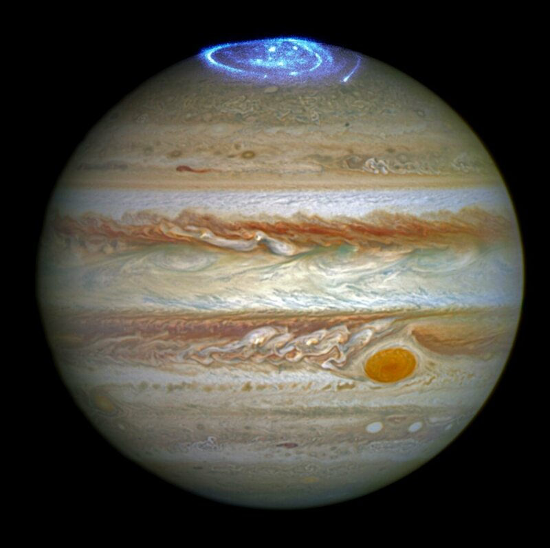 An optical image of Jupiter, taken by Hubble in 2014, is overlaid with an ultraviolet image taken by Juno in 2016.