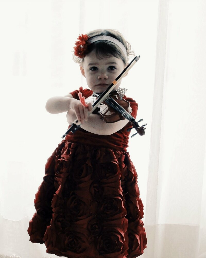 The World's Smallest Violin and the Tiny Musicians Who Play