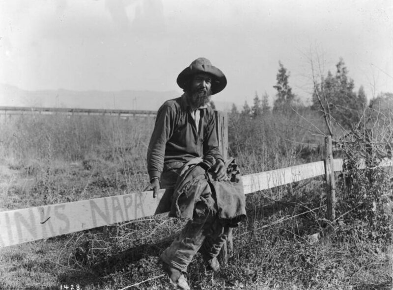 Hobo sitting on a fence, c.1920