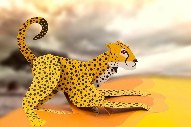 A close-up of a pop-up book paper cheetah.