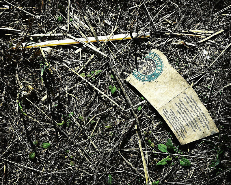Trash in the form of a McDonalds straw and Starbucks drink wrapper.
