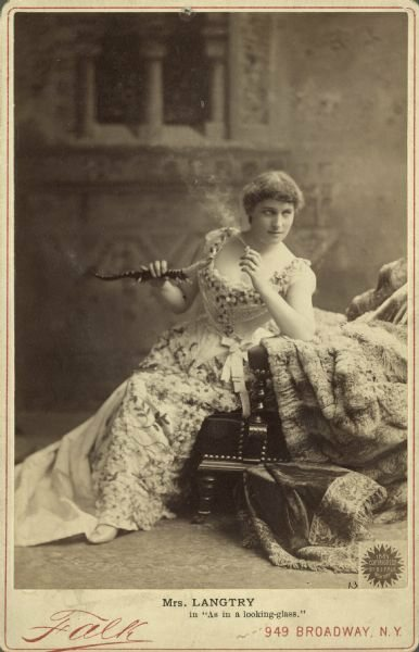 Lillie Langtry in character as the adventuress Lena Despard from the 1887 play <em>As in a Looking-Glass</em>.