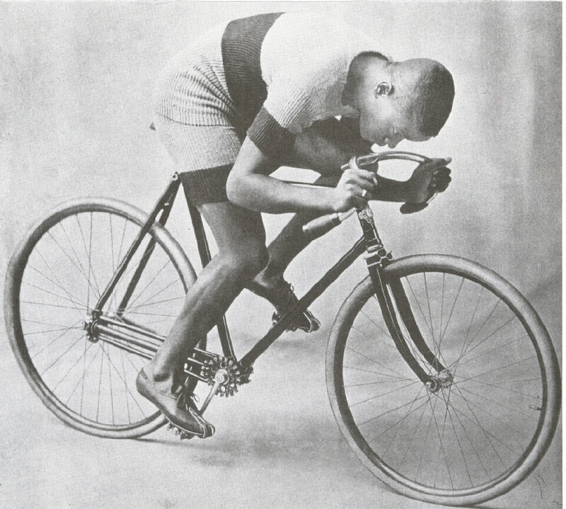 Taylor riding the chainless bicycle that Munger built for him, in 1899.