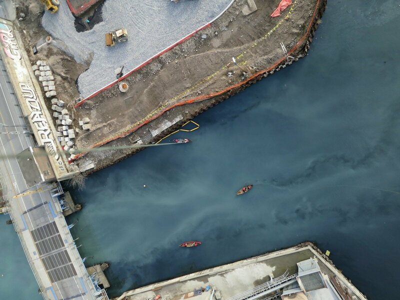 A balloon photo of the Gowanus Canal in Brooklyn, string clearly visible at left.