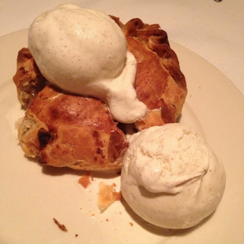 Apple pie with cheddar cheese crust and ice cream.