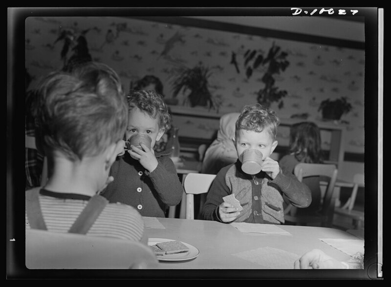 Children snack on milk and graham crackers, 1943.