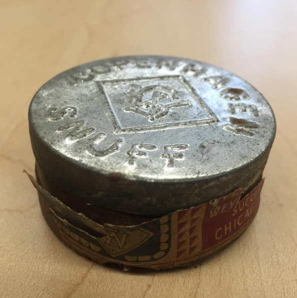 A can of snuff that hopefully didn't belong to a student.