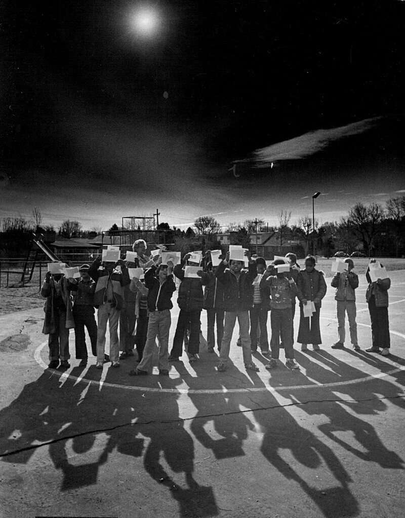 Pupils at a school in Denver watch projections of the solar eclipse, 1979.
