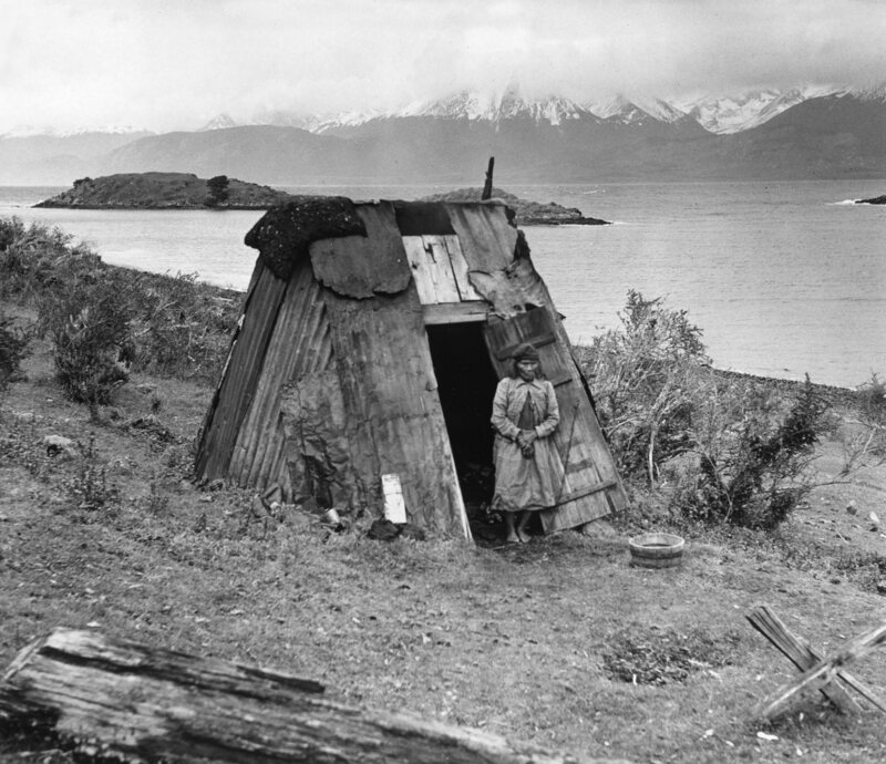 A Yaghan woman outside her hut, Chile.