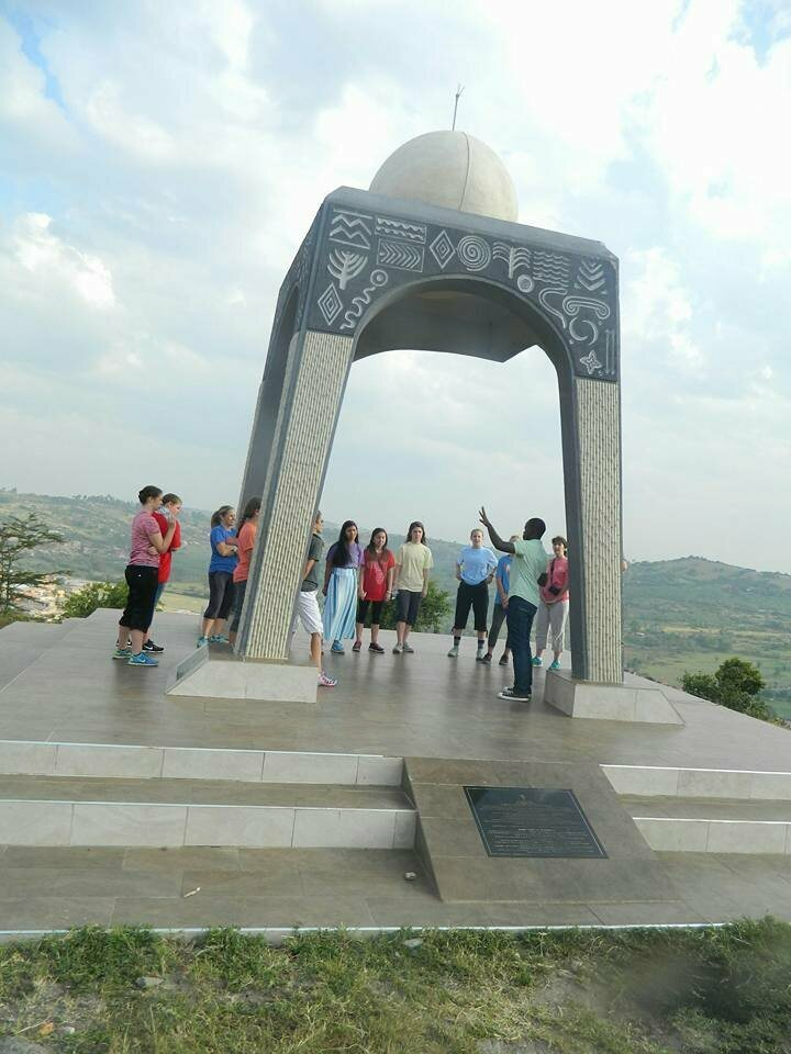 Visitors check out the Biharwe eclipse monument.